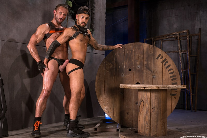 Myles Landon grabs Talon Reed's leather harness driving his hard cock deeper inside his ass